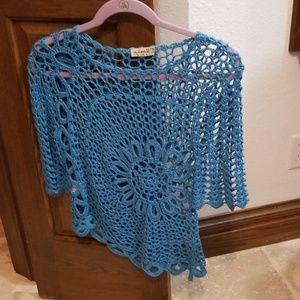 Crochet blue top. Never been worn.
